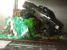 Grooms Mudding cake, This is what i had in mind, with landscape around the cake, i really like the water fall as well