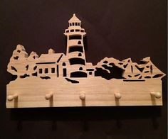 A beautiful lighthouse and landscape scene cut out of 3/4 inch Select Pine wood. Great for hanging on the wall to hold keys, key chains, etc. Dimensions: 10 inches wide x 6 inches tall.