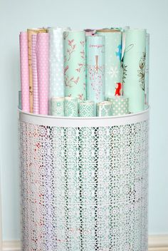 METAL LAUNDRY HAMPER USED TO STORE WRAPPING PAPER (BLOG WITH CRAFT ROOM ORGANIZING TIPS)