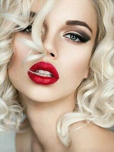 She knows the power of a red lip...