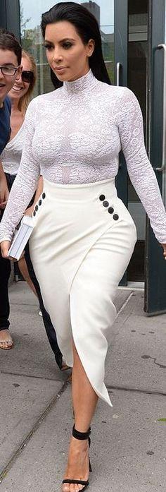 Who made  Kim Kardashian's white button skirt, print top, and black sandals?