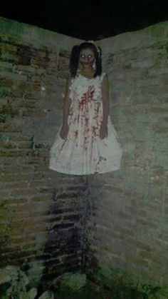 The little girl had blood on her white dress and a bloody grin on her face. But she wasn't very happy. Folks in Amarillo still see her, sometimes.