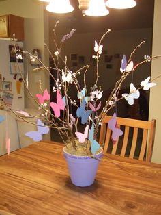 I made this butterfly tree for a friend of mine last year.  She's a huge butterfly fan.  I got the idea from a Better Homes and Garden magazine.  I used real branches from my tree and then heavy scrapbooking paper to cut out the different sized butterflies.  I added some light design on the butterflies.  The pot is a basic clay pot that I painted and I used a styrofoam ball to stick the branches in and then covered it with moss.