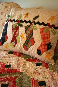"Sewn With Grace: The Stockings Were Hung - from the book ""'Tis the Season"" ************************************* I like the Stocking applique, the rickrack, and the red and green log cabin quilt. another Christmas quilt on the list. Christmas Applique, Christmas Sewing, Noel Christmas, Christmas Projects, Holiday Crafts, Christmas Stockings, Christmas Quilting, Xmas, Country Christmas"