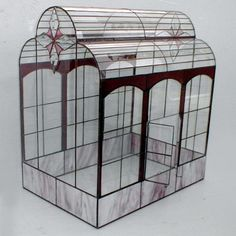 'Mauve Victorian' ~ Stained glass terrariums that are made in the Tiffany tradition, each designed and hand made by Ron Gladkowski. They are featured on The Terrarium Museum site. Terrarium Containers, Air Plant Terrarium, Glass Terrarium, Stained Glass Mirror, Fused Glass, Victorian Terrariums, Hanging Potted Plants, Mini Greenhouse, Terraria