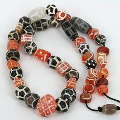 A stand of ancient decorated Carnelain and agate beads   Mixed Western and central Asia origin.