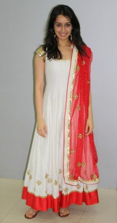 White and red combination anarkali with golden work on dupatta..