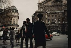 Philip-Lorca diCorcia: Paris 1996. I chose to include this image because I feel as though it has similar yet different aspects to how street photography is typically done. The image still has a high contrast, yet instead of the people being in the light so you can see the details, they are in shadow and the buildings are in light. I also really admire the timing in terms of the main people that seem to follow a line that ends between the buildings.