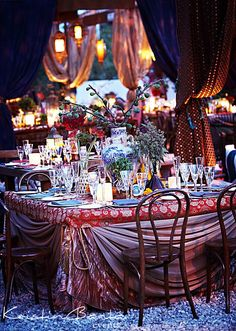 This Gypsy, old-world inspired wedding featured tons of unconventional accessories and unique fabrics. #kristinbanta #weddings #tablescapes #tabletops #flowers #centerpiece #reception #weddingreception #brown #purple #red #gypsy #revelry #linens #fabrics