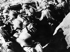 German soldiers before the attack. typical of World War I trench warfare attacks…