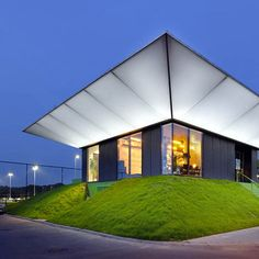 This pavilion with illuminated eaves was designed for two football teams in Rotterdam