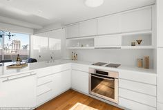 A chefs dream: The kitchen is sleek and modern with white worktops and steel appliances ov...