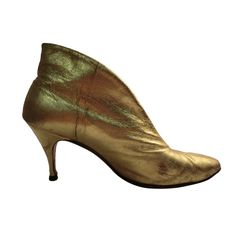1950s Gilt Leather High Throated Stiletto Booties | From a collection of rare vintage shoes at http://www.1stdibs.com/fashion/accessories/shoes/
