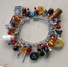 I love stuff like this: Geeky and Crafty! Loaded charm bracelet. And a Harry Potter theme!