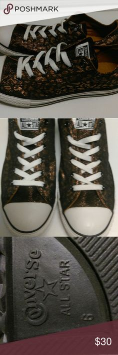 Converse All Stars NWOT Metallic Leopard print. The Metallic isn't as copper as a penny is, I would say it's a goldish/ bronzish color. I think the camel color interior of the shoe make it look more bronze, than gold. Converse Shoes Sneakers