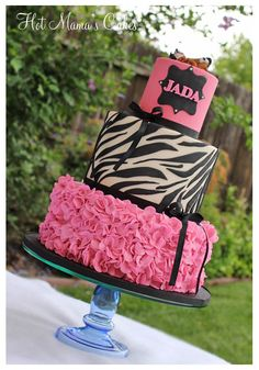 Pink and Zebra Print ruffles Baby Shower - Hot pink petal ruffles with zebra print patterns. The baby was sculpted using a silicone mold. I just added the zebra print clothes to match. I used the Bloom cake tutorial on the petal technique for the bottom tier. Really easy, but time consuming. The top tier is actually a faux tier. I just wanted to add extra height to it. :)