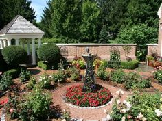"""This classic rose garden features dozens of varieties of roses, plus shaped shrubs and annual flowers. The attached tea pavilion is a great place for brunch with a full view of the walled garden."" From David J Frank Landscape Contracting, Inc in Germantown, Wisconsin."