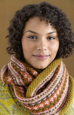 Feel festive by wearing this knitted cowl made in Wool-Ease.