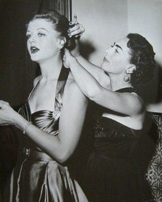 Joan Crawford fixing Angela Lansbury's hair. Crawford had previously had a relationship with Lansbury's husband.