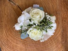 Classic and timeless combination of white roses and carnations to compliment the bouquets.