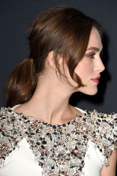 Curl shorter layers around your face to keep your style causal yet chic, like Keira Knightley.