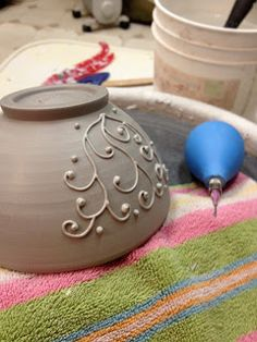 slip trailing. @Amy Eisenhut we gotta take ceramics again. Even if it's a 6th class.