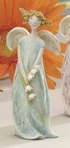 Angel holding Lily of the Valley flowers. Paper Mache Sculpture, Sculpture Art, Sculptures, Ceramic Figures, Ceramic Art, Clay Angel, Pottery Angels, Angel Artwork, Ceramic Angels