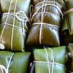 Costa Rican tamales are wrapped in green banana tree leaves.