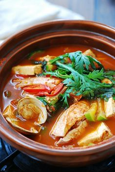 Domi Maeuntang (Spicy Fish Stew with Red Snapper) One of the classic Korean stew dishes is this spicy fish stew, called maeuntang. In Korea, maeuntang is made with all sorts of fish, including freshwater ones. For this recipe, I made it with a red snapper Spicy Recipes, Fish Recipes, Seafood Recipes, Asian Recipes, Soup Recipes, Cooking Recipes, Healthy Recipes, Healthy Food, K Food