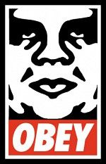 Street artist Shepard Fairey's famous OBEY tag featuring Andre the Giant's big brother like stare and dystopian sentiments to STAY ASLEEP and OBEY
