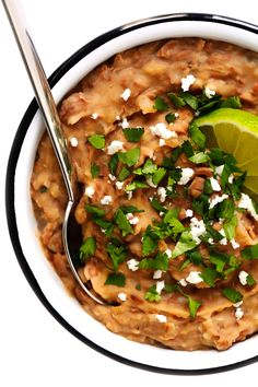 This homemade refried beans recipe is easy to make in about 20 minutes with vegetarian ingredients you can feel great about! Its the perfect easy Mexican side dish, or can be added to tacos, burritos, enchiladas and more. Or just serve with tortilla chips as an easy dip! | gimmesomeoven.com #refriedbeans #mexican #dip #side #glutenfree #vegetarian #vegan #healthy #cincodemayo
