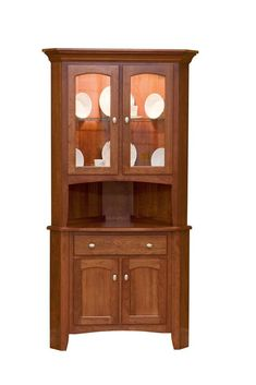 Amish Concord Corner Hutch Leola Collection The Concord Corner hutch is a traditional Amish Corner Hutch. It's distinctive features include a gentle curve in the upper indentations of cabine
