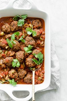Moroccan Kefta Meatballs made with tomatoes and olives are simmered together in the slow cooker or Instant Pot in this easy and exotic Moroccan dinner.