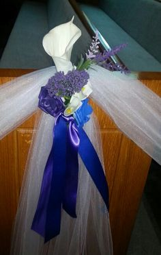 Pew marker....Single white calla lilly accented with purple and blue flowers and ribbons