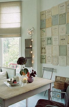 The shades of blue and yellow and natural are beautiful in the vintage sheet music wall art.  ||  Office and Craft Rooms #office #inspiration #vintage