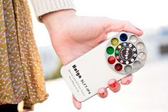 RAINBOW SMARTPHONE CAMERA CASES    Instead of buying a ton of lenses for one's smartphone camera, one can simply purchase the Holga iPhone Lens that comes as a rotating ring of lenses that can be attached to the back of an iPhone.