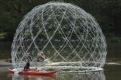 There is a stunning metallic dome floating on the Bronx River in New York City right now—this fragile-looking structure is made of discarded umbrellas salvaged from the city's streets and recycled plastic bottles.  Created by husband-and-wife design team Amanda Schachter and Alexander Levi of SLO Architecture, the Harvest Dome 2.0 had a predecessor that was accidentally destroyed while being installed—this newer and better version has been made possible by a successful Kickstarter campaign.