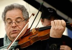 Itzhak Perlman owns two Stradivari and a Guarneri. I would say that I'm quite envious, except that no one else's playing compares to his... thus if anyone is going to own three of the best instruments ever made, it should be him! He is my absolute favorite violinist, closely followed by Joshua Bell.
