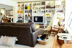 A wall of bookshelves and a tent to boot!  Love the feel of this room!