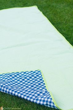 Reversible Waterproof Picnic Blanket - This free sewing pattern is the perfect easy blanket pattern for summer. Using whole cloth quilting techniques and simple binding, this blanket is the must-have accessory for beach and park goers this summer. Using a waterproof fabric, the Reversible Waterproof Picnic Blanket ensures that your relaxing time out in the sun stays lovely and dry.