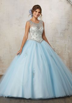 Morilee Quinceanera Dresses  STYLE NUMBER: 89129 Jeweled Beading on a Tulle Ballgown  Fresh and Feminine, This Tulle Quinceañera Dress Features a Beautiful Illusion Neckline Beaded with Jewel Details. Beaded Appliqués Throughout Skirt. Matching Stole Included. Keyhole Corset Back. Colors Available: Light Blue/Champagne, Light Coral/Nude, White.