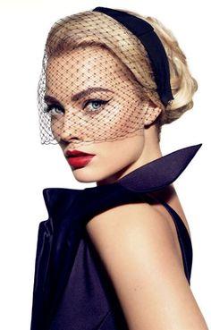 Margot Robbie poses with headpiece for Vanities