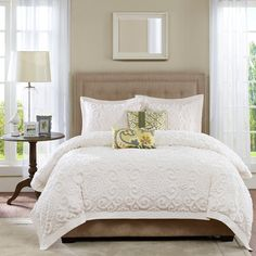 Complement a refined, resort-inspired aesthetic or accentuate bright throw pillows with this lovely comforter set, featuring a textured scroll design and crisp white hue.
