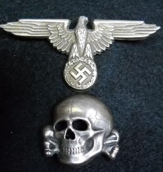 German  World War Two Waffen or Allegemine SS Metal Skull & Eagle SS Period Hat Set.