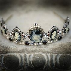 Gothic-inspired headpiece incorporates a series of black and ivory cameos