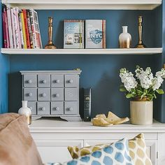 Cosy library nook with eclectic display