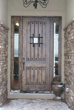 Beautiful door and love the stone wall look