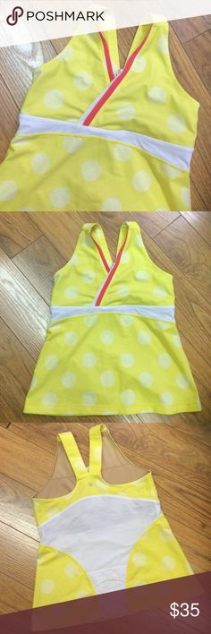 LuluLemon polka dot workout top This top is proof you can have fun while you're working out. Bright lemon yellow (brighter than the pics show) with lined white polka dots for a fun twist.  White inset at the waist and and across white breathable inset across the majority of the back. Salmon rose and white flat piping accent the bust.  There's a pocket on the back as well. Their top is in awesone condition.  Size 10 lululemon athletica Tops