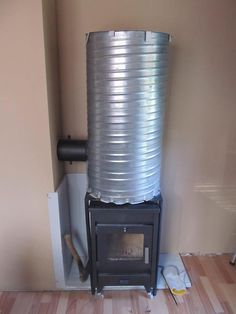 This is a way to make your wood source last longer and for you to get more heat from your stove; converting your existing wood stove into a rocket stove. Diy Outdoor Toys, Rocket Mass Heater, Garage Tool Storage, Homemade Furniture, Fire Pit Designs, Stove Oven, Rocket Stoves, Wood Burner, Homesteading