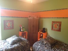 Green walls with orange stripe and camo duck tape for the border.